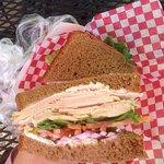Turkey sandwich on homemade bread and yummy bowl