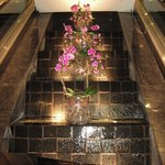 Waterfall and orchids arrangement inside hotel foyer