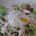 Chicken Caesar salad topped with a soft poached egg