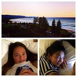 Comfy in bed and our gorgeous view at sunset over North Wollongong Beach