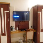 Big LCD tv with fridge and tea maker