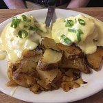 Eggs Benedict with Crab Filling and a Side of Potatoes