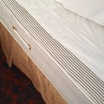 The white topping with stitching is the mattress topper.