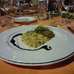 Risotto con zucchine, peperoni, salsa di sagrantino passito e maiale