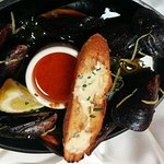 Half order of the delicious roasted mussels.