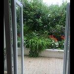 Patio doors off kitchen/diner into private garden.