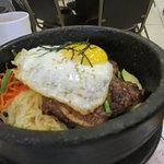 BBQ Beef short-ribs, fried egg and rice in stone pot