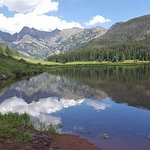 Beautiful refection of Upper Piney Lake with mountain backdrop.