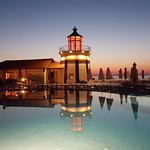The lighthouse overlooking the pool, in the evening
