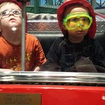 3 year olds in firetruck