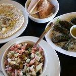 Hummus, fresh pita, Dolmades, and Jerusalem salad.