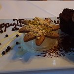 Happy birthday written in chocolate, chocolate rum pound cake with coconut ice cream and cookie