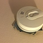 Smoke detector over sheet metal and hole in wall