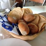 Basket of bread and tostadas while yo wait for your food!