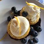 Olive oil cake with blueberries compote and citrus marscapone
