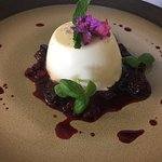 Lovely Madagascan vanilla panacotta with fruit compote and micro basil