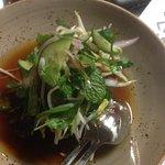 Caramalised sticky pork, sour herb salad & chili vinegar