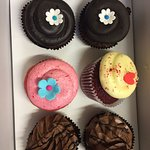 We had received this delightful gift on someones bday. Cute looking yummy cupcakes .