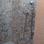 Shower with natural stone tiles.