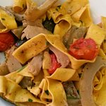 Fettuccine special with cherry tomatoes, artichokes and grilled zuchini