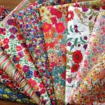 Stacks of fabric are sold to benefit VQM biannually