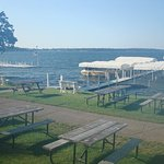 Picnic tables in front of the lakeside rooms