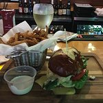 Red Snapper on pretzel bun w/grilled asparagus, béarnaise, lettuce, tomato. Onion straws w/horse