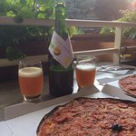 Pizza from Palme d'Or and organic local beer on the patio