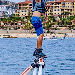 FLYBOARD  It's a new water sport, there's a board under your feet with two strong jet thrusters