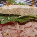1/2 a turkey BLT sandwich on butter bread
