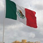 Giant flag that awaits the ferry passengers from Playa Del Carmen to Cozumel