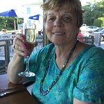 Enjoying a glass of Prosecco.