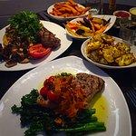 Steak, barnsley lamb chop with a myriad of sides