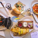 Spread of menu offerings - mussels, Maritime Chowder, Lobster Mac & Cheese, Beer battered haddoc