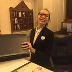 Sara! Our favorite employee shown here at the front desk.
