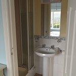 En Suite bath showing shower (toilet is hidden in this photo)