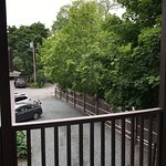View out front door of Room 8 - of driveway (main house to the left)