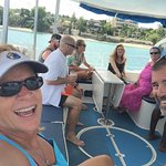 On the back of the catamaran.