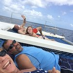 On the front of the catamaran.