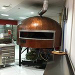 This is the coolest pizza oven I've seen - the pies circle the inside