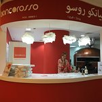 The front counter of this food court location in Al Raha Mall.