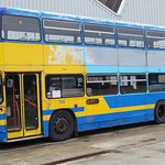 A Leyland Olympian parked in the yard.