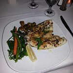 Loved the garlic sauced mussels as an appetizer followed by tasty Branzino white fish.