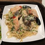 Chicken piccata and seafood linguine