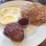 Flapjacks, house made pork sausage patties, and two eggs over hard (the eggs were perfect!