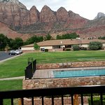 view of the pool area and the mountains behind