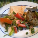 Lentil patty with flat breads, dips and salad