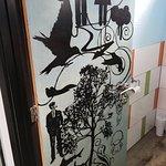 the funky art on the rest room door (exterior)