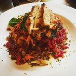 Health Kick Salad with a grilled chicken breast. Pomegranate dressing, cabbage, spinach, Quinoa,