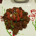 Lamb dish chilli chicken & different chutneys